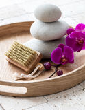 Inner beauty and nail care with relaxing stack of stones Royalty Free Stock Image
