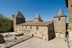 Inner building of carcassonne chateau. Carcassonne is a ancient and fortified town in Aude department south France. It was added to the UNESCO list of World Stock Photos