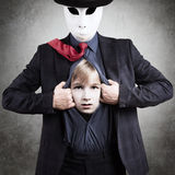 Inner child, concept. Man in mask showing his Inner child, psychological concept Stock Photo