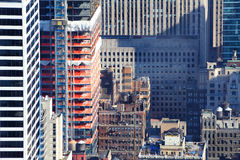 Inner city building construction. New inner city building construction amongst older traditional buildings, New York, Manhattan Royalty Free Stock Images