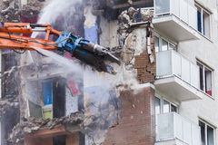 Inner city demolition of High rise building Stock Photo