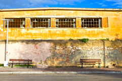 Inner city. Ghetto street view with abandoned building Royalty Free Stock Image