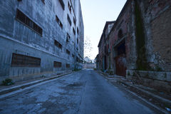 Inner city. Ghetto street view with abandoned buildings stock photos