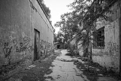 Inner city ghetto street view. Black and white photo of inner city ghetto street view with abandoned buildings Royalty Free Stock Photography