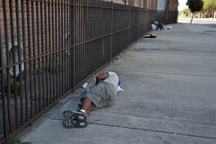 Inner City Homeless and Drug Abuse-Sleeping on City Sidewalk. Social-Inner-Inner City Homeless and Drug Abuse-Sleeping on City Sidewalk Royalty Free Stock Photos