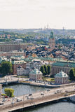 Inner city of Stockholm. With the House of Nobility and the Storkyrkan cathedral in the front and the Djurgarden island in the back Stock Photography