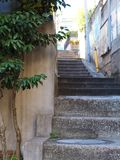 Inner city urban stairs going onward and upward. Back alley staircase in the inner city moving forward and upward. Wonderful natural and subtle backdrop of Royalty Free Stock Photography