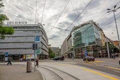 Inner city of Zurich, Switzerland. Zurich, Switzerland - June 10, 2017: Inner-city of Zurich with old and modern buildings. Tram rails in front Stock Photos