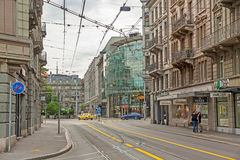 Inner city of Zurich, Switzerland. Zurich, Switzerland - June 10, 2017: Inner-city of Zurich with old and modern facade buildings. Tram rails in front Royalty Free Stock Photography