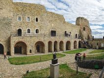 Inner Court of medieval Neamt Citadel, Romania. Targu Neamt, Romania - September 5, 2017: Inner Court of medieval Neamt Citadel with walking tourists stock photography