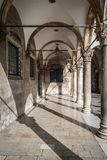 Inner courtyard and corridor in Dubrovnik Old Town. Inner courtyard and arched corridor in Dubrovnik Old Town, Croatia Royalty Free Stock Images