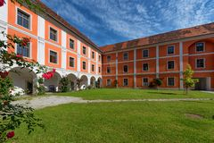 Inner courtyard of Jesuit monastery in Judenburg, Austria. Inner courtyard of a former Jesuit monastery in the center of the medieval trading town of Judenburg stock images