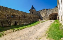 Inner courtyard of old medieval castle. Stara Lubovna, Slovakia - AUG 28, 2016: inner courtyard of old medieval castle. tower and entrance in to the castle Stock Image