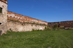 Inner courtyard of an old ruined castle with royalty free stock image