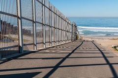 Inner Fence of International Border Wall Extending to Pacific Ocean Stock Image