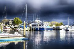 Inner Harbor Hyannis Massachusetts stormy sky. A variety of different boats docked in the inner harbor on Lewis Bay in Hyannis Massachusetts against a stormy sky royalty free stock photos