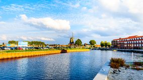 The harbor of Harderwijk in the Netherlands. The inner harbor with the traditional windmill in the historic fishing village of Harderwijk in Gelderland province stock photography