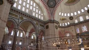 Inner part of the large dome in the structure of the Suleymaniye Mosque. Turkey, Istanbul - 5 June 2019: inner part of the large dome in the structure of the stock footage