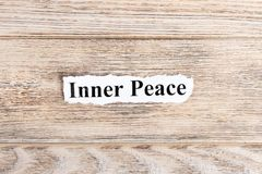 Inner Peace text on paper. Word Inner Peace on torn paper. Concept Image.  Stock Images