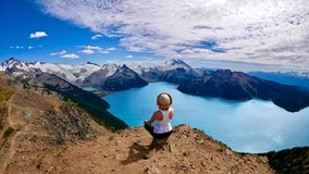 Inner peace. Woaman doing yoga above alpine lake. Royalty Free Stock Photos