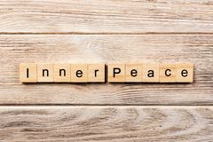 Inner peace word written on wood block. inner peace text on table, concept stock photography