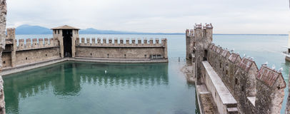 Inner pier protected by a Scaligero fortress wall in Sirmione Royalty Free Stock Images