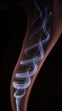 Inner smoke. Abstract colorful smoke on black background Royalty Free Stock Images