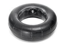 Inner tube. An old inner tube on a white background Stock Photo