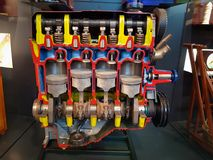 Combustion engine. Inner workings of an inline four cylinder combustion engine stock photos