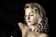 Inner world. Blond woman lit by natural light glamour portrait Stock Images