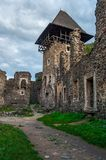 Inner yard and tower of Nevytsky castle. Ruins of medieval fortress, popular tourist destination of TransCarpathia Royalty Free Stock Photos
