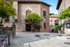 Inner yard of traditional Spanish village Poble Espanyol with cafes and gift shops. Royalty Free Stock Images