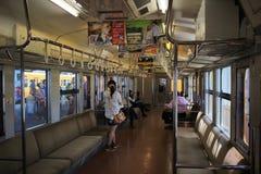 Innere des JR.-Zugs reisen von kure Linie ab Lizenzfreie Stockfotos