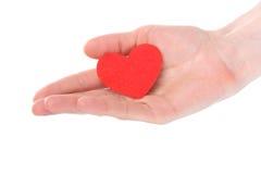 Inneres des Valentinsgrußes in der menschlichen Hand Lizenzfreie Stockbilder