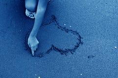 Inneres gezeichnet auf Sand Stockfotos