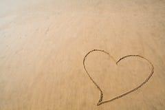Inneres gezeichnet in Sand Stockfotos