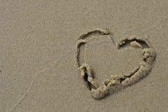Innerzeichen auf dem Sand Lizenzfreie Stockfotografie