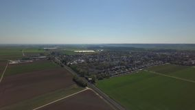 Inningen, a suburb of Augsburg in Germany. Aerial drone footage of Inningen, a suburb of Augsburg in Germany. View over the houses, plants and fields stock video