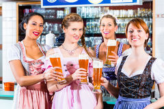 Innkeeper and guests drinking beer in Bavaria royalty free stock photos