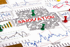 Innocation concept with financial graphs and charts Stock Images