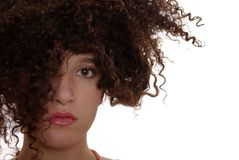 Innocence. Innocent teenager with naturally curly hair with white background Stock Photos