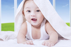Innocence baby smiling on bed Stock Photos