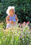 Innocence and flowers Stock Photos