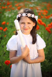 Innocence and purity. Girl child portrait (9-10) in her first holy communion, rite of passage, clear conscience Stock Images