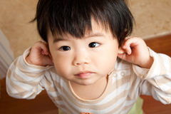 Innocent Baby Girl. A baby girl with innocent face stock photo