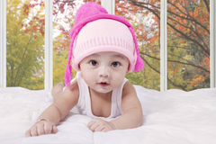Innocent baby with hat at home Royalty Free Stock Photos