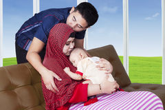 Innocent baby with muslim parents Stock Image