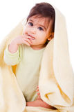 Innocent baby wrapped with a yellow towel Stock Photo
