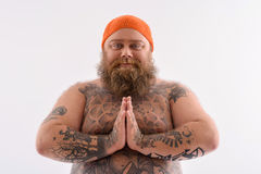 Innocent bearded fatty with tattoo Royalty Free Stock Image
