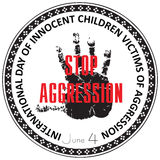 Innocent Children Victims of Aggression. International Day of Innocent Children Victims of Aggression, stamp Stop Aggression Royalty Free Stock Images